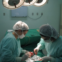 RN assisting surgeon in Gordo AL